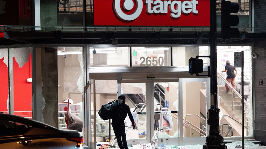 Security Alarm System -A looter rob a Target store as protesters face off against police in Oakland California on May 30, 2020, over the death of George Floyd